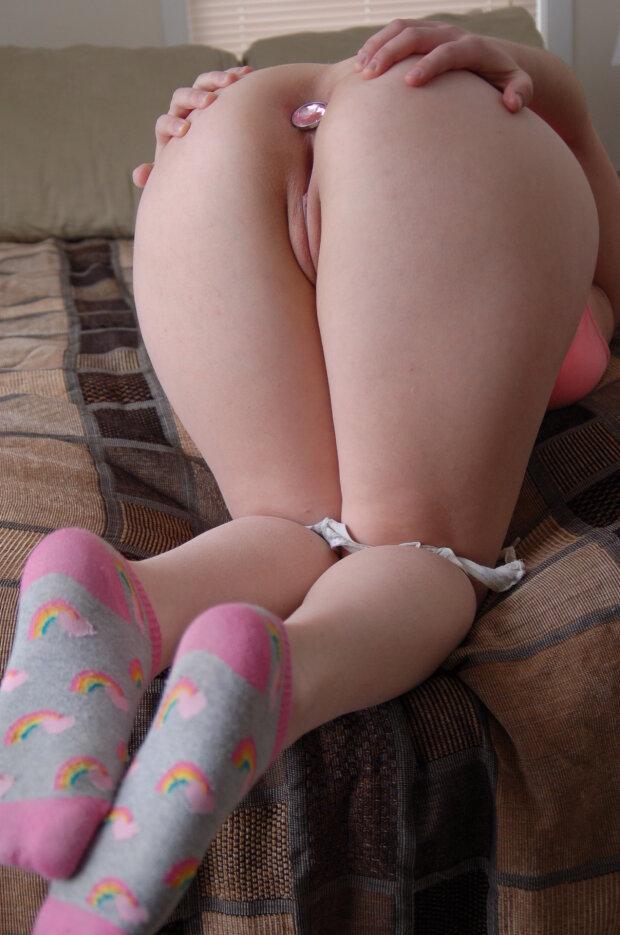 Cute socks, a little pussy and an anal plug
