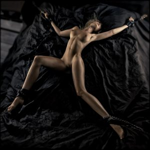 A babe with stunning body restrained on bed