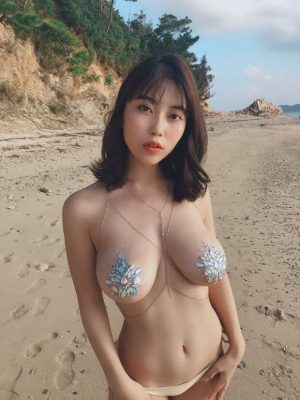Beautiful asian babe with awesome tits