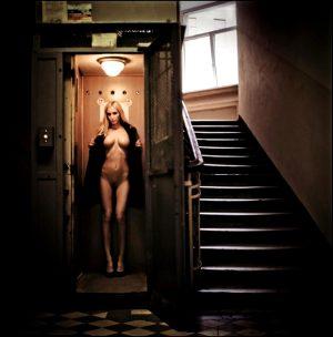 blonde exhibitionist woman in elevator