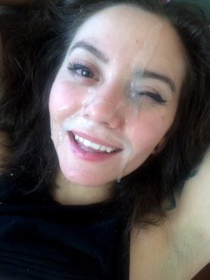 Brunette with cum on her face