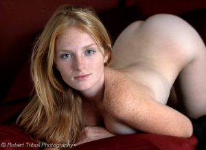 Cute strewberry blonde cutie with lots of freckles