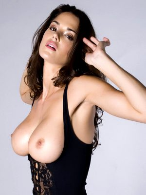 Hot brunette flashes her tits