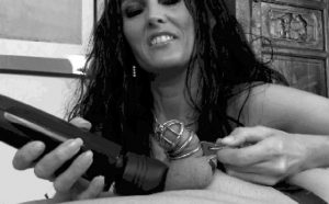 mistress laughs while causing a ruined orgasm to her slave in chastity cage