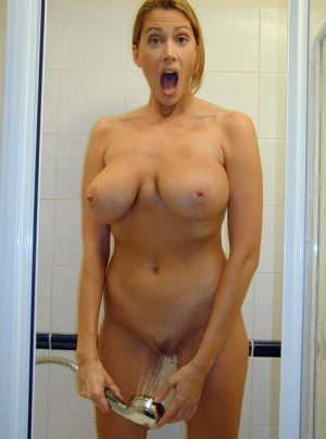 Mommy got caught pleasuring her feel good place with the shower head