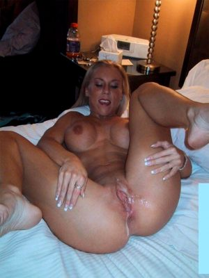 Pussy stuffed and oozing with cum in a hotel room