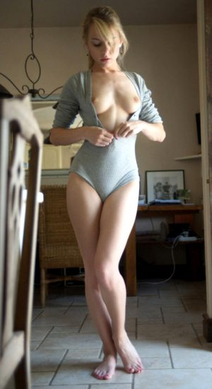 Sexy Blonde Putting on Clothes