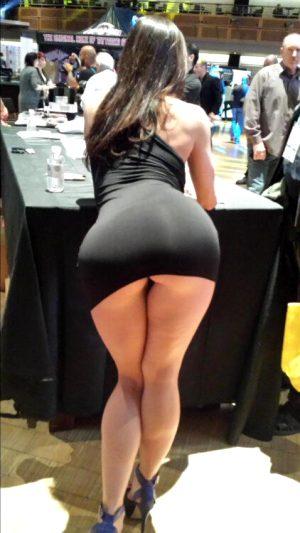 Tight black dress, bent over